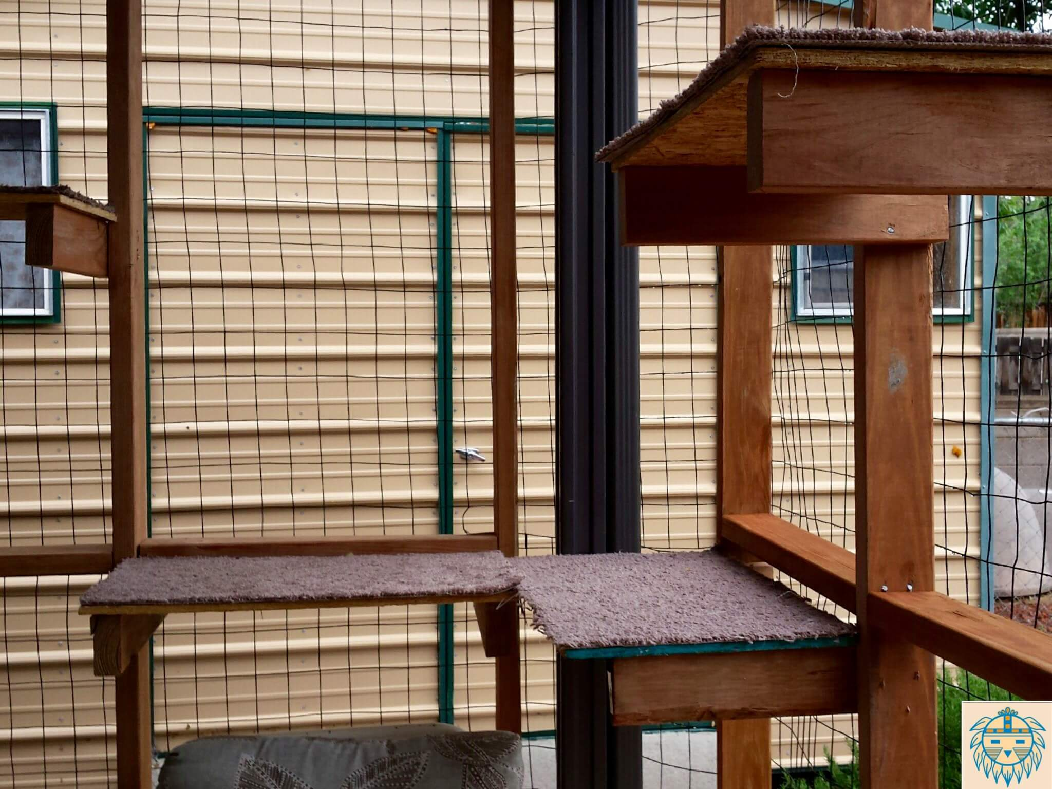 "Built in perches enable the cats to observe the outdoor in a comfortable place ""above"" the bustle of the world. The addition of a bird feeding station safely outside the enclosure can also provide much enjoyed visual stimulation for your cats. This is one that one of our client built for their cats."